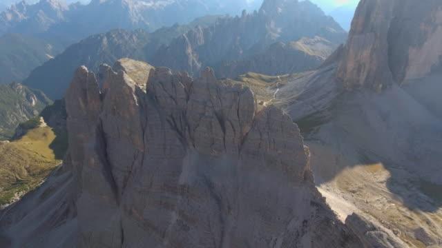 aerial:mountain range ,dolomites italy - tre cimo di lavaredo stock videos & royalty-free footage