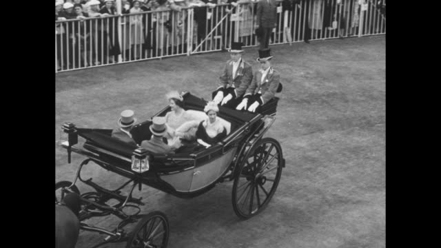 aerials ascot racecourse as the royal family arrives in open horsedrawn carriages / queen elizabeth ii with prince philip duke of edinburgh and... - princess margaret 1950 stock videos and b-roll footage