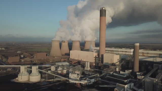 aerials biomass and coal-powered power station - condensation stock videos & royalty-free footage