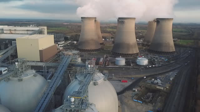 aerials cooling towers at power station - condensation stock videos & royalty-free footage