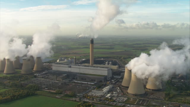 aerials drax coal fired power station smoke coming from cooling towers in selby north yorkshire - fossil fuel stock videos & royalty-free footage