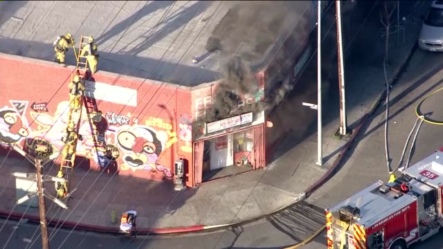 ktla aerials eightyfour firefighters extinguished a stripmall fire in east hollywood on wed feb 25 2015 - centro commerciale suburbano video stock e b–roll
