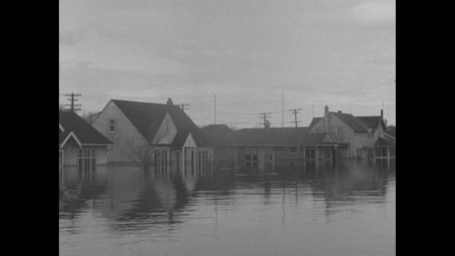 aerials flooded neighborhoods of winnipeg / vs houses flooded up to their porches and higher and up to the eaves / hand points at marker on water... - depth marker stock videos & royalty-free footage