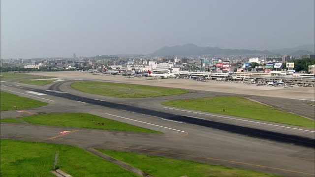 aerials fukuoka airport - fukuoka prefecture stock videos & royalty-free footage