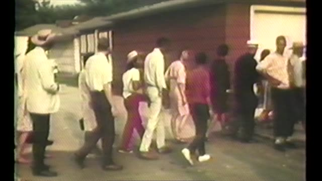 wgn aerials ground shots of civil rights protesters marching racists and police in chicago's suburb cicero on september 4 1966 also cars turned over... - 1966 stock-videos und b-roll-filmmaterial