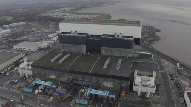 aerials heysham nuclear power station, uk - ランカシャー点の映像素材/bロール