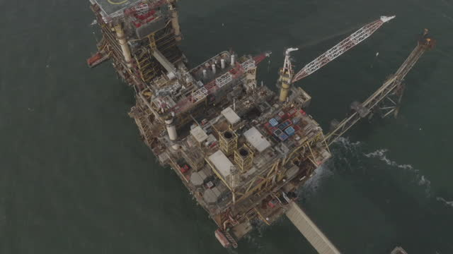 aerials morecambe bay offshore gas field platforms - construction machinery stock videos & royalty-free footage