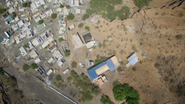 vidéos et rushes de aerials: new solar panels power a village in cape verde - de petite taille