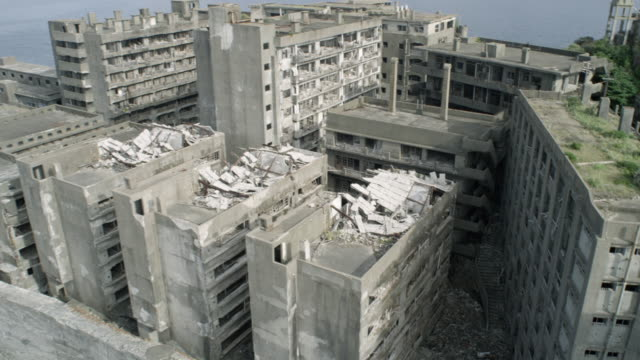 aerials of abandoned hashima island - island stock videos & royalty-free footage