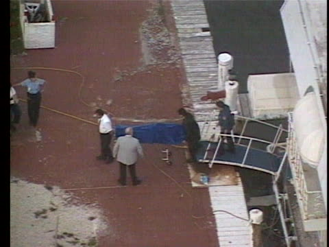 aerials of andrewêcunananõs body being carried out of a miami beach houseboat.êcunananêcommitted suicide just eight days after shooting and killing... - miami stock videos & royalty-free footage