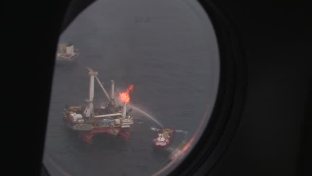 Aerials of BP Deepwater Horizon oil well site with response ships gathered Discover Enterprise and Q4000 burning off natural gas and oil Aerials of...