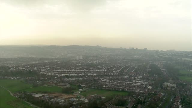 aerials of brighton; england: south east: ext **quality as incoming** air views planes on tarmac at airport / fields east sussex: brighton: air views... - ブライトン パレスピア点の映像素材/bロール
