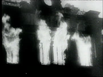 aerials of burning stalingrad after nazi attack / burning buildings, smoke / man carrying damaged cello from burned-out building / survivors walking... - civilian stock videos & royalty-free footage