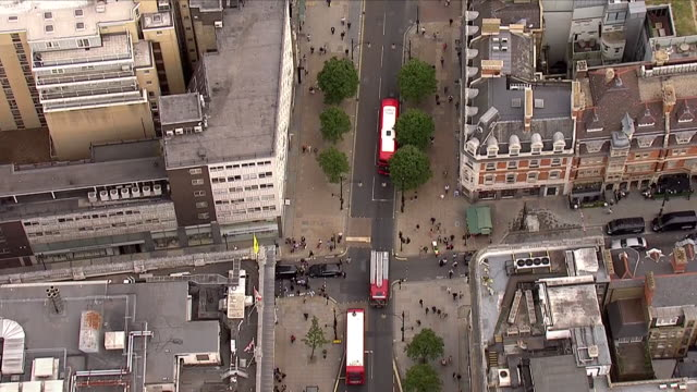 aerials of busy oxford street showing traffic and people walking including aerials of house of fraser on 7th june 2018 in london united kingdom - oxford street stock-videos und b-roll-filmmaterial