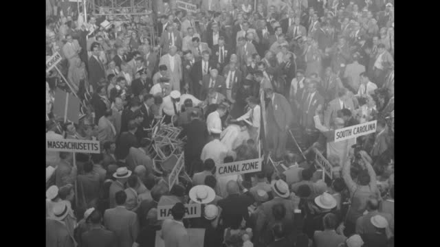 aerials of crowded floor of 1952 democratic national convention in chicago with state signs and delegates / delegates and fire marshals putting out a... - confederate flag stock videos & royalty-free footage