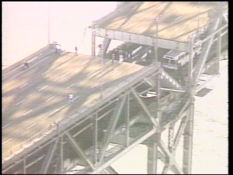 / aerials of damaged portions of bay bridge / cars trapped crushed by bridge collapse loma prieta earthquake / bay bridge collapse on october 18 1989... - oakland california stock videos & royalty-free footage