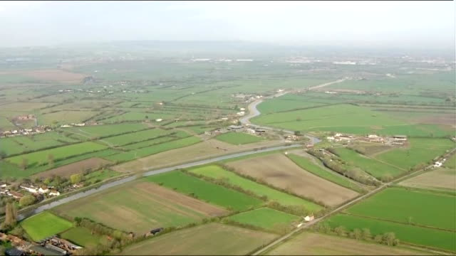 aerials of dredging on somerset levels england somerset levels over river / digger dredging river / farmland and countryside/ ruin on mound in... - somerset levels stock videos and b-roll footage
