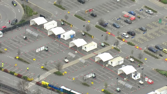 aerials of drive through coronavirus testing centre for nhs staff in ikea car park in london - car park stock videos & royalty-free footage