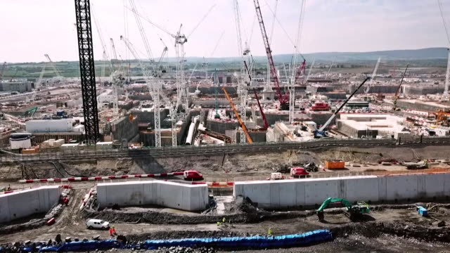 aerials of edf nuclear plant under construction at hinkley point in somerset - building activity stock videos & royalty-free footage