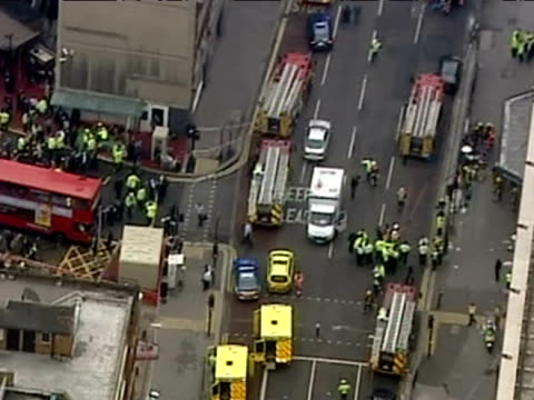 aerials of emergency services outside aldgate station after 7/7 bombings - exclusive footage - no sale to any news organisations - bombardamento video stock e b–roll