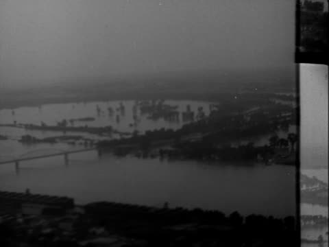 aerials of flood damage in st charles missouri / high waters cover the landscape / aerial of street covered by water where a lake had burst / aerial... - 1951 stock videos & royalty-free footage