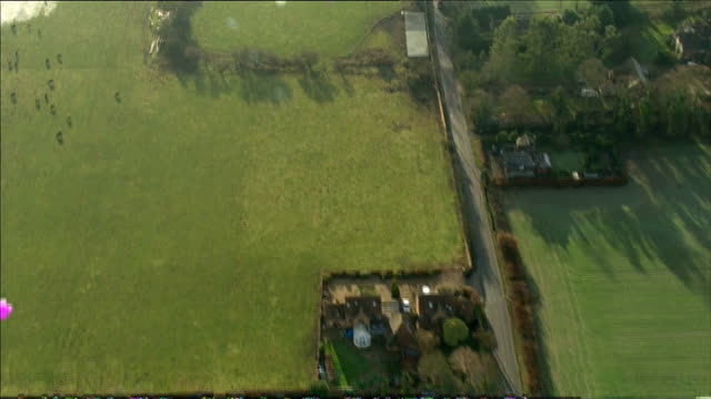 aerials of flooding in england; **picture quality as incoming - some picture distortion** berkshire: air views flooded a4094 road at widbrook common... - paul daniels stock videos & royalty-free footage