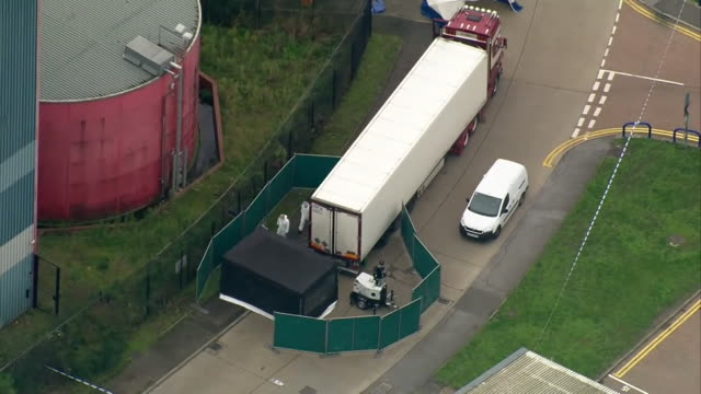 aerials of forensic police at lorry containing 39 bodies in grays in essex - cordon boundary stock videos & royalty-free footage