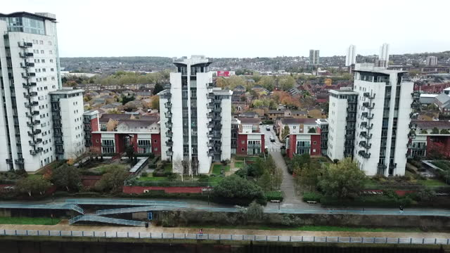 aerials of high rise buildings in the royal artillery quays in thamesmead, london, all have flammable cladding - skyscraper stock videos & royalty-free footage