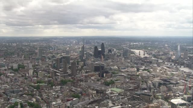 aerials of hsbc headquarters in canary wharf air views arials of city of london and river thames including gherkin the cheese grater - grater utensil stock videos and b-roll footage