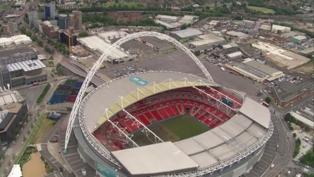 aerials of hsbc headquarters in canary wharf; england: london: canary wharf: ext air views - aerials of wembley stadium - wembley stock videos & royalty-free footage
