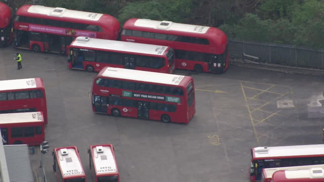 aerials of london buses that are essential services in london during lockdown due to coronavirus crisis - bus stock videos & royalty-free footage