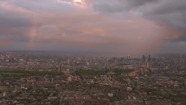 aerials of london skyline at sunset with cloudy sky and rainbow in sky - stimmungsvoller himmel stock-videos und b-roll-filmmaterial