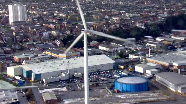"""aerials of lowestoft port including shots of wind turbine """"gulliver"""", britain's tallest wind turbine, located at ness point. some frost and snowfall... - ローストフト点の映像素材/bロール"""