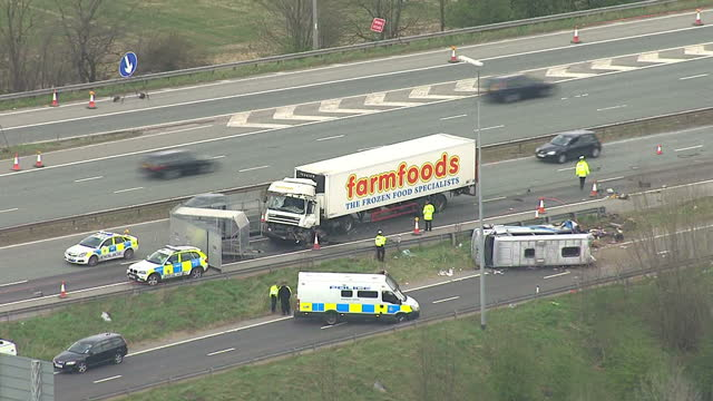 vídeos de stock, filmes e b-roll de aerials of motorway crash with farmfoods lorry and minibus on carriageway with emergency services at scene of accident crash on m62 motorway kills... - despedida de solteira