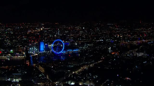 Aerials of New Year's Eve over London ENGLAND London VIEWS / AERIALS fireworks in garden / Vauxhall / central London and River Thames with...
