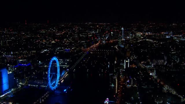 Aerials of New Year's Eve over London ENGLAND London Illuminated Tower Bridge over River Thames / nigh time cityscape / Somerset House courtyard with...