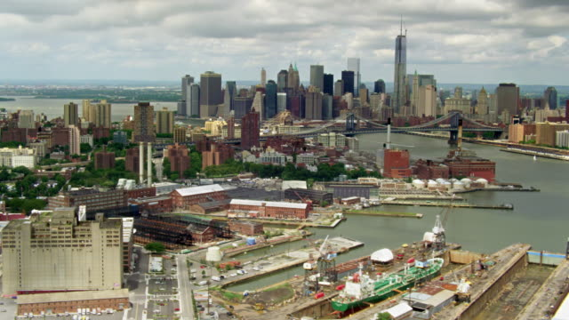 Aerials of New York City, Brooklyn, Navy Yard and Vinegar Hill in the foreground, East River, Manhattan Bridge and Lower Manhattan in background