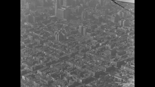 aerials of new york city from a plane with wing in frame / empire state building and skyscrapers / cu top of empire state building / aerials... - grounds stock videos & royalty-free footage