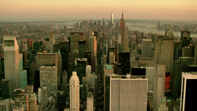 aerials of new york city, looking south down 5th ave, past midtown manhattan and the empire state building toward the financial district, one world trade center, freedom tower, at sunset - twilight stock videos & royalty-free footage