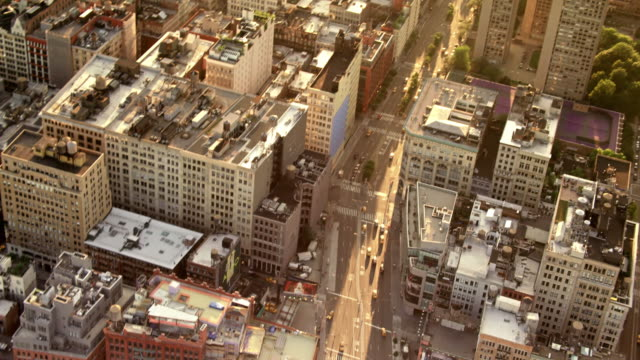 Aerials of New York City, Manhattan, Looking down at Houston Street, SOHO , at sunset