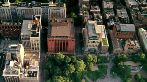aerials of new york city, manhattan, looking down into washington square park, greenwich village, at sunset - greenwich village stock videos & royalty-free footage