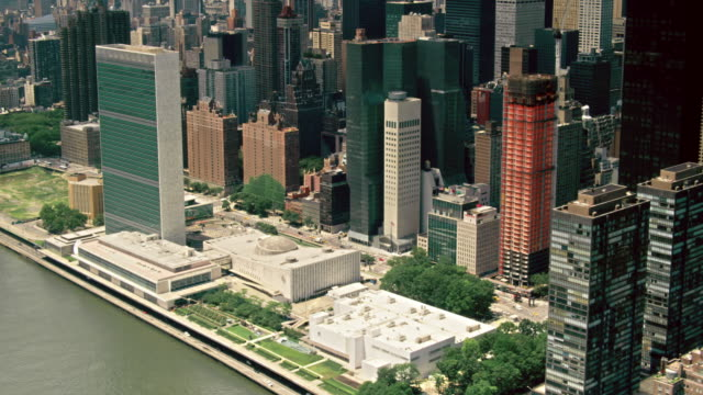 aerials of new york city, manhattan, the united nations building, midtown east - united nations building stock videos and b-roll footage