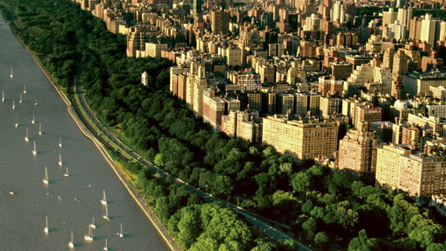 aerials of new york city, manhattan, upper west side, henry hudson parkway, west side highway, riverside park, at sunset - upper west side manhattan stock videos and b-roll footage