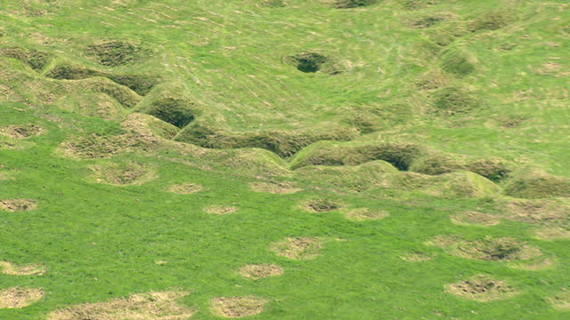 aerials of newfoundland memorial park site of the somme battlefield with original front line trenches and shell craters still visible - trench stock videos & royalty-free footage