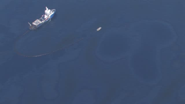 Aerials of oil recovery site of DeepWater Horizon oil spill site oil spill patterns on water the ship Discoverer Enterprise surrounded by other ships...