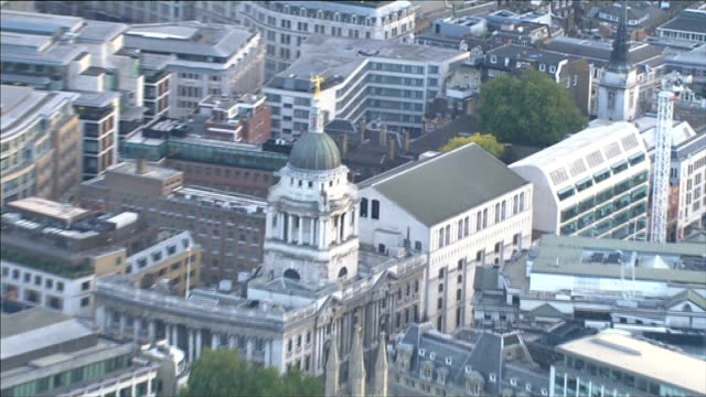 aerials of old bailey more air views of london cityscape including river thames the shard old bailey / central crimal court entrance / lady justice... - statue of justice london stock videos and b-roll footage