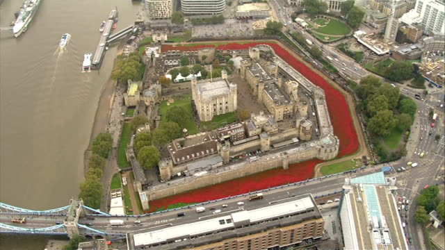aerials of poppy installation at tower of london england london tower of london ext / misty air views the shard pan over river thames to tower of... - moat stock videos & royalty-free footage