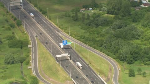 aerials of port of calais closed by strike; all air views - aerials / traffic queueing on the road leading to the eurotunnel terminal / migrants... - eurotunnel folkestone stock-videos und b-roll-filmmaterial