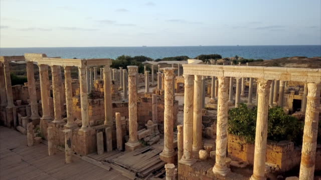aerials of roman ruins of leptis magna in libya - archaeology stock videos & royalty-free footage