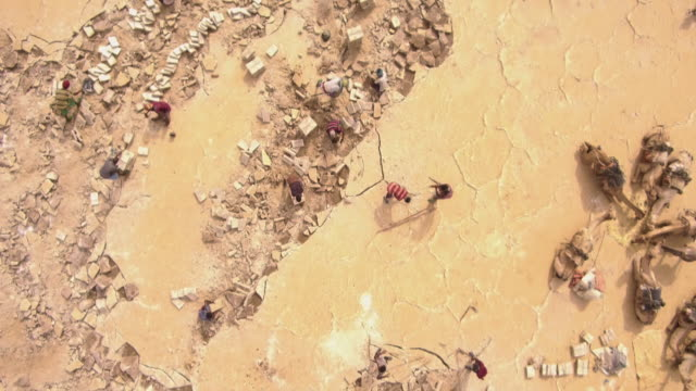 aerials of salt being mined by hand, ethiopia - mineral stock videos & royalty-free footage